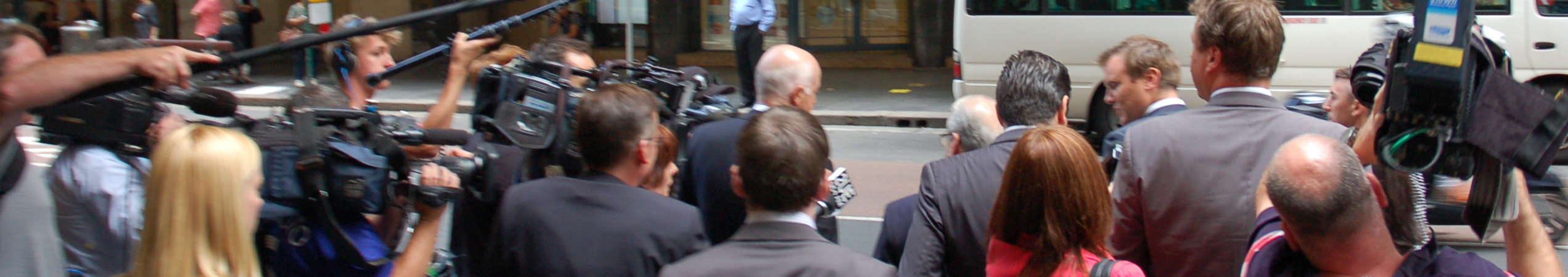 press surrounding witnesses leaving a public inquiry